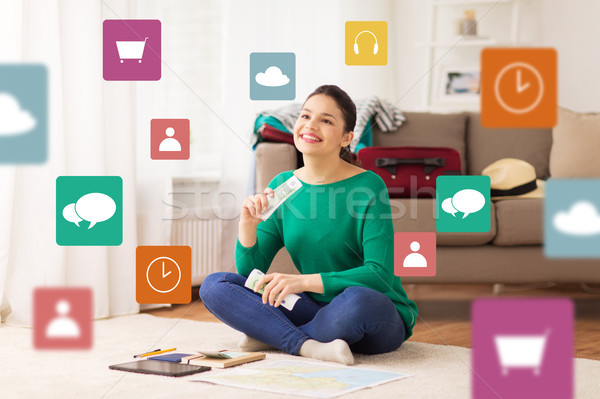 happy woman with money and travel map at home Stock photo © dolgachov