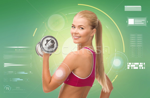 happy sporty woman with dumbbell flexing biceps Stock photo © dolgachov