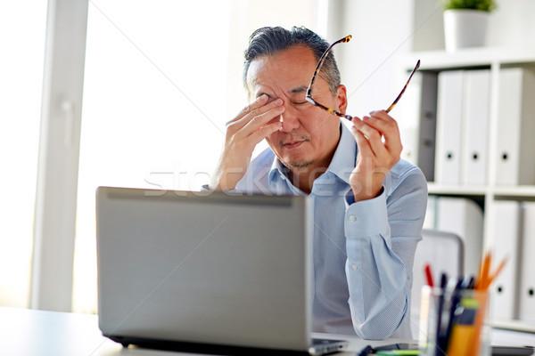 Moe zakenman bril laptop kantoor business Stockfoto © dolgachov