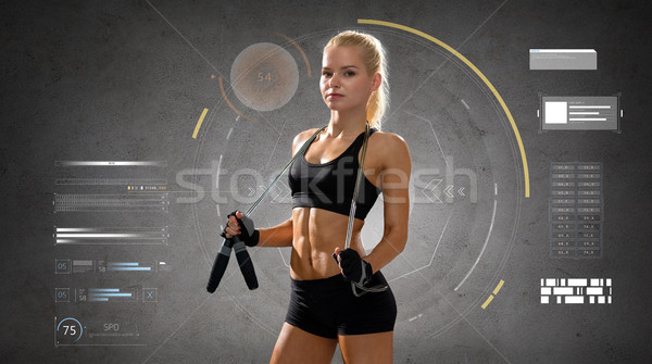 young sporty woman with jumping rope Stock photo © dolgachov