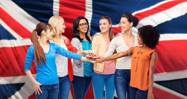 united nternational women over british flag Stock photo © dolgachov