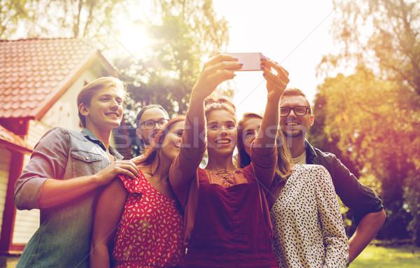 Barátok elvesz buli nyár kert szabadidő Stock fotó © dolgachov