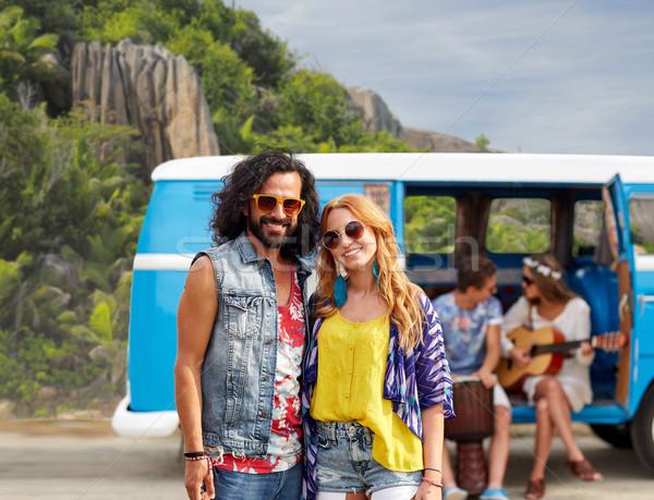 happy hippie couples and minivan on island Stock photo © dolgachov