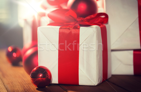 close up of gift boxes and red christmas balls Stock photo © dolgachov