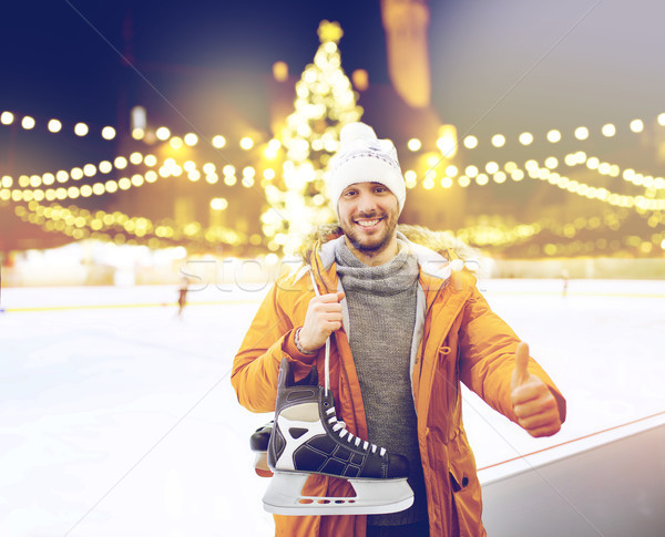 man showing thumbs up on christmas skating rink Stock photo © dolgachov