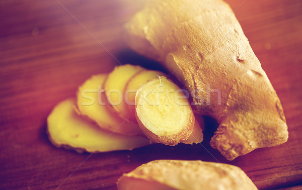 Stock photo: close up of ginger root on wooden table