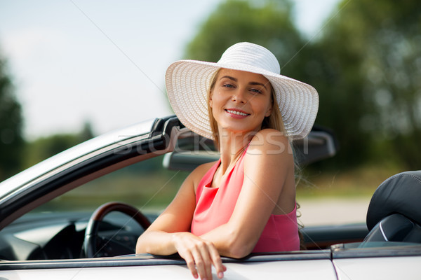 happy young woman in convertible car Stock photo © dolgachov