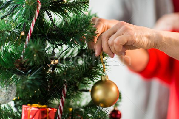 Közelkép idős nő karácsonyfa ünnepek emberek Stock fotó © dolgachov
