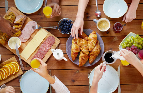 Stock photo: group of people having breakfast at table