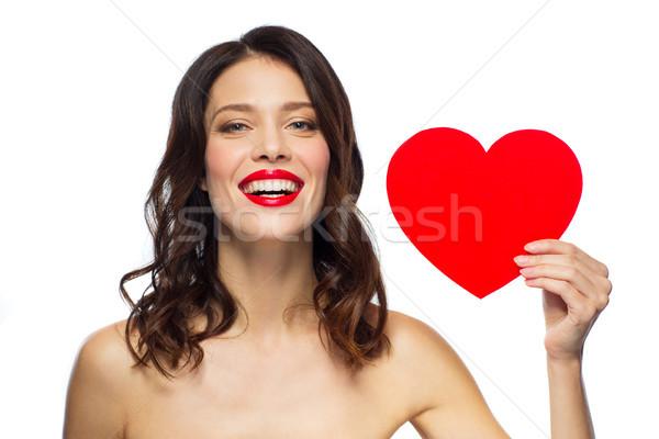 Bela mulher batom vermelho forma de coração dia dos namorados beleza pessoas Foto stock © dolgachov
