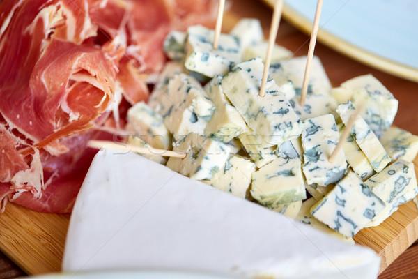 Formaggio tipo gorgonzola prosciutto alimentare catering mangiare Foto d'archivio © dolgachov