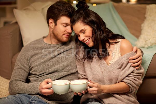 Mutlu çift içme kakao ev boş Stok fotoğraf © dolgachov
