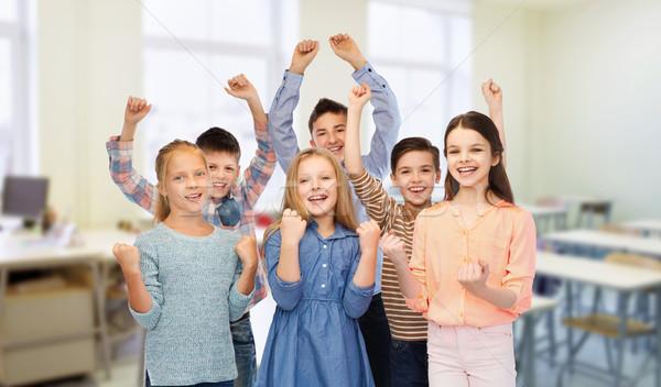 Gelukkig studenten vieren overwinning school onderwijs Stockfoto © dolgachov