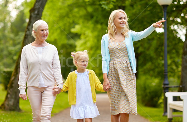 happy mother, daughter and grandmother at park Stock photo © dolgachov