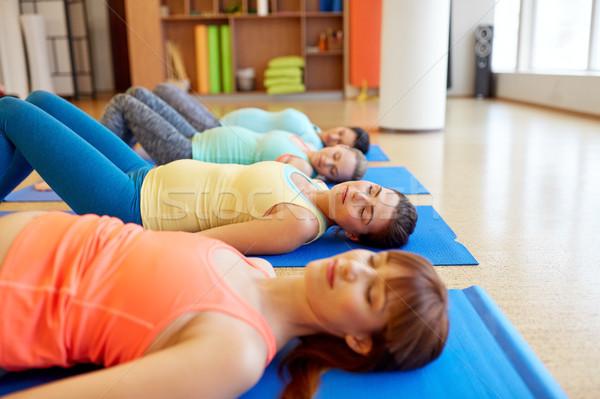 pregnant women lying on mats in gym Stock photo © dolgachov