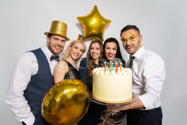 Boldog barátok nagy torta születésnapi buli ünneplés Stock fotó © dolgachov