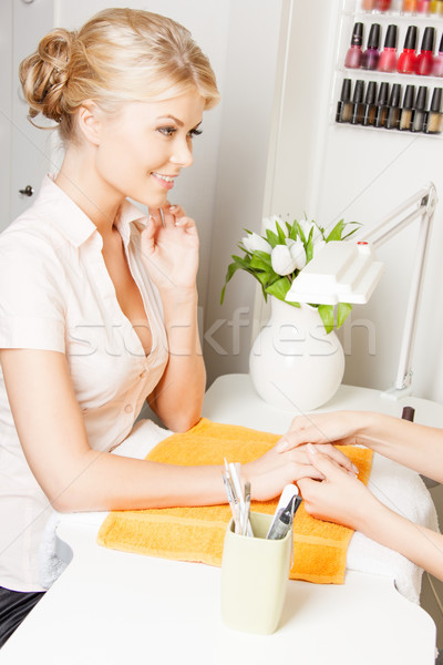 woman having a manicure at the salon Stock photo © dolgachov