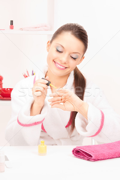 woman polishing her nails Stock photo © dolgachov