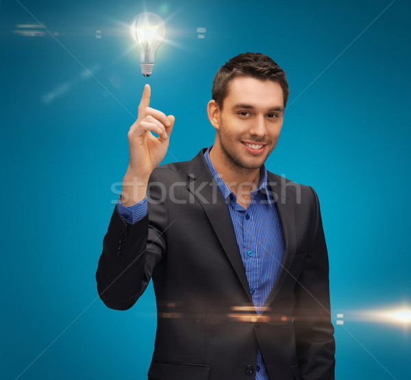 man in suit with light bulb Stock photo © dolgachov