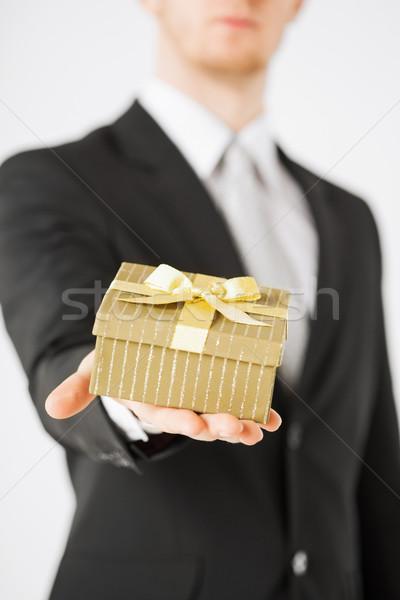 man hands holding gift box Stock photo © dolgachov