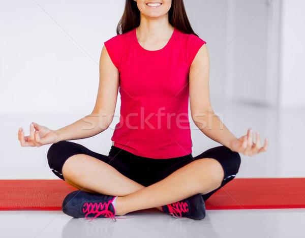 girl sitting in lotus position and meditating Stock photo © dolgachov