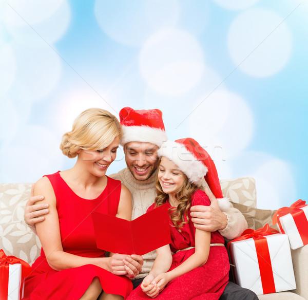 улыбаясь семьи чтение открытки Рождества рождество Сток-фото © dolgachov