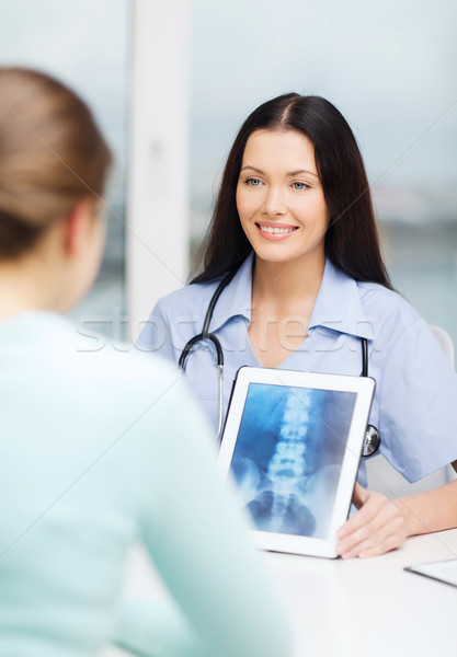 doctor or nurse showing x-ray with tablet pc Stock photo © dolgachov