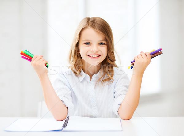 Mosolyog lány mutat színes tollak oktatás Stock fotó © dolgachov
