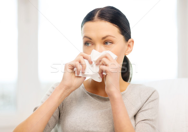 sick girl with paper tissue Stock photo © dolgachov