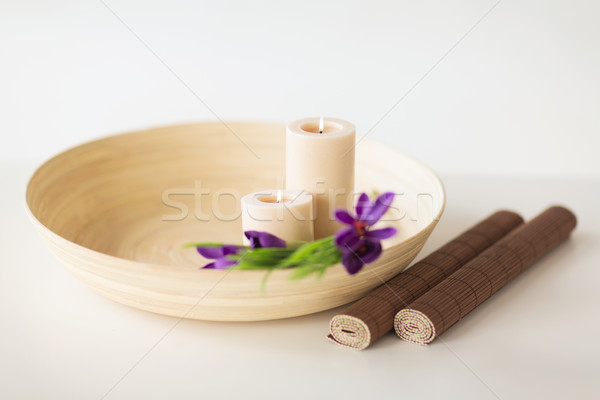 candles and iris flowers in wooden bowel and mat Stock photo © dolgachov