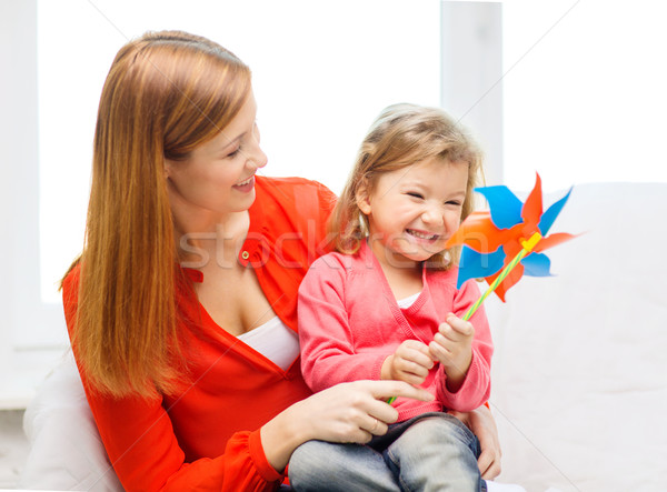 happy mother and daughter with pinwheel toy Stock photo © dolgachov
