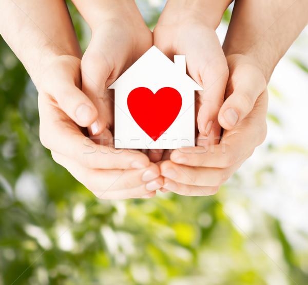 couple hands holding white paper house Stock photo © dolgachov