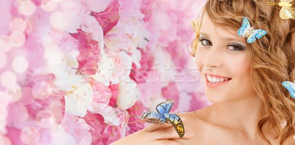 Gelukkig tienermeisje vlinders haren gezondheid schoonheid Stockfoto © dolgachov
