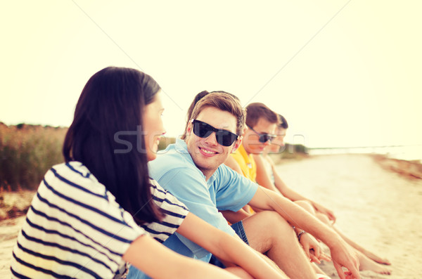 group of friends or volleyball team on the beach Stock photo © dolgachov