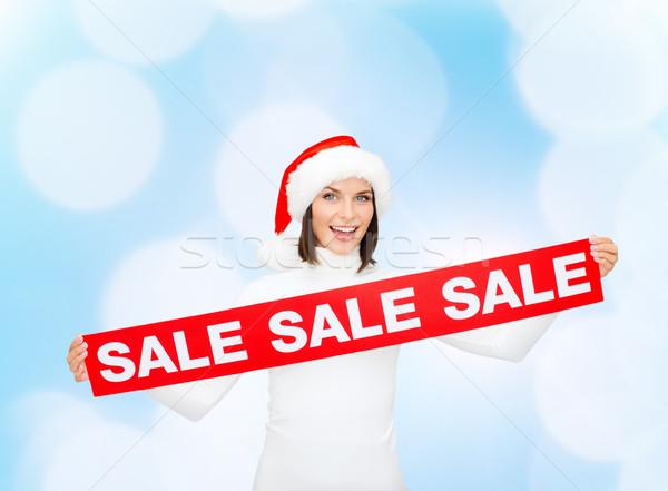 Glimlachende vrouw helper hoed verkoop teken Stockfoto © dolgachov