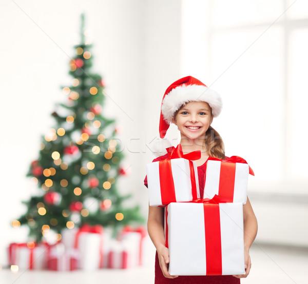 Dziewczyna Święty mikołaj pomocnik hat wiele Zdjęcia stock © dolgachov