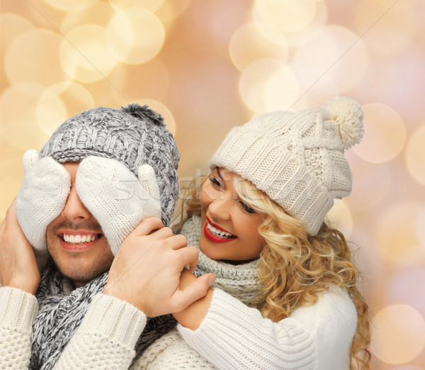 smiling couple in sweaters and santa helper hats Stock photo © dolgachov