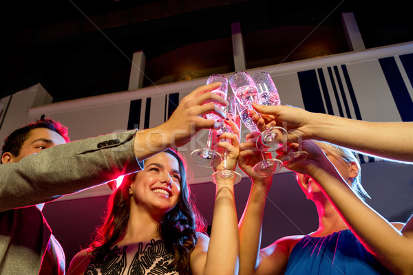 Glimlachend vrienden bril champagne club partij Stockfoto © dolgachov