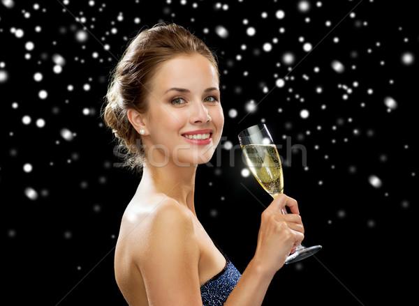 улыбающаяся женщина стекла вино напитки Сток-фото © dolgachov