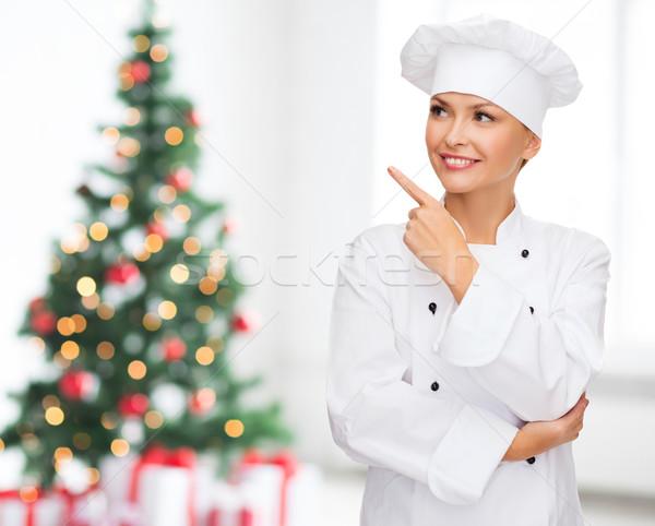 Mosolyog női szakács álmodik mutat ujj Stock fotó © dolgachov