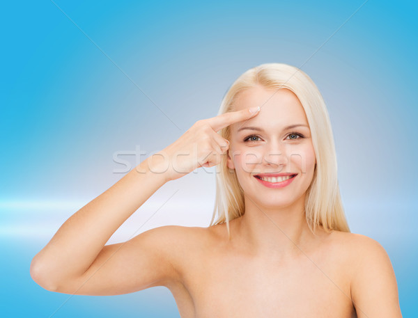 Belle femme toucher front santé beauté visage Photo stock © dolgachov