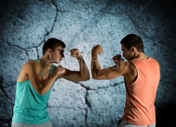 Jonge mannen vechten sport concurrentie sterkte mensen Stockfoto © dolgachov