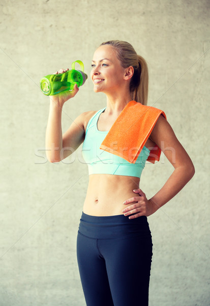 woman with bottle of water in gym Stock photo © dolgachov
