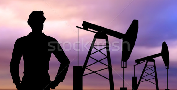 black silhouette of oil worker and pump jack Stock photo © dolgachov