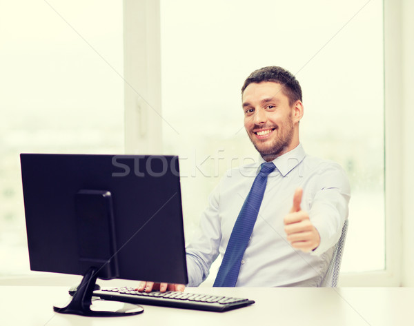 smiling businessman or student with computer Stock photo © dolgachov