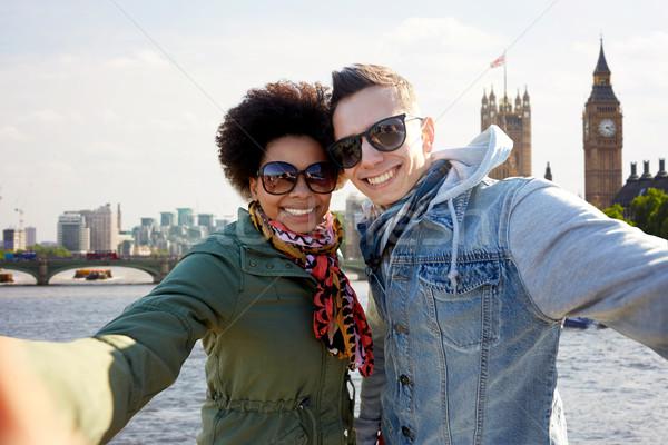 happy teenage couple taking selfie in london city Stock photo © dolgachov