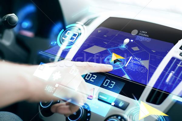 male hand using navigation system on car dashboard Stock photo © dolgachov