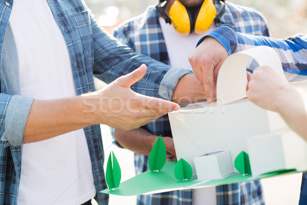close up of builders with paper house model Stock photo © dolgachov