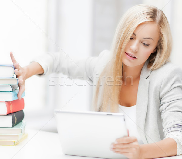 student with books and tablet pc Stock photo © dolgachov