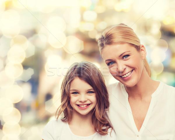 Mosolyog anya kislány család gyermekkor boldogság Stock fotó © dolgachov